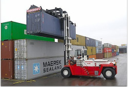Loaded container handler with top-lift spreader